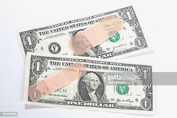 Adhesive tapes on US dollar bills