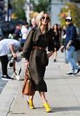 Adi Heyman is seen outside the Diane Von Furstenberg show wearing a Lanvin trenchcoat Celine bag and Oliver Peoples sunglasses on September 7 2014 in...
