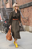 Adi Heyman is seen outside the Thakoon show wearing a Lanvin trenchcoat Celine bag and Oliver Peoples sunglasses on September 7 2014 in New York City