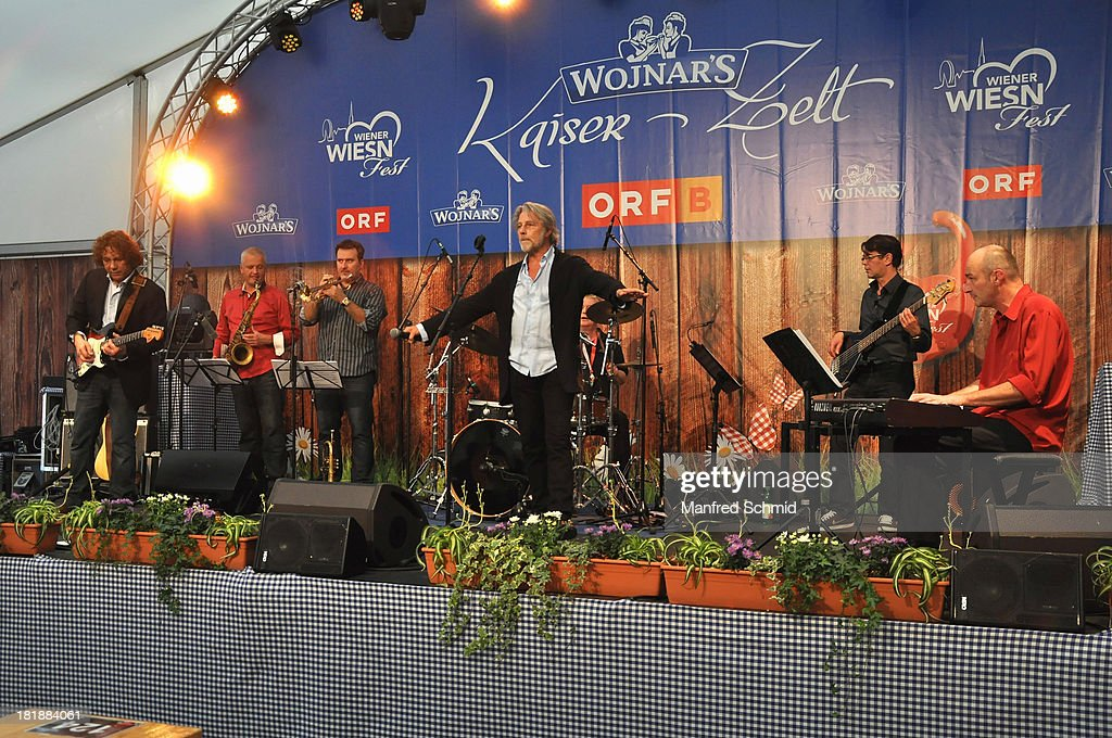 Adi Hirschal (C) and band members perform on stage during the 'Wiener Wirten Tag' as part of Wiener Wiesn Festival 2013 on September 25, 2013 in Vienna, Austria.