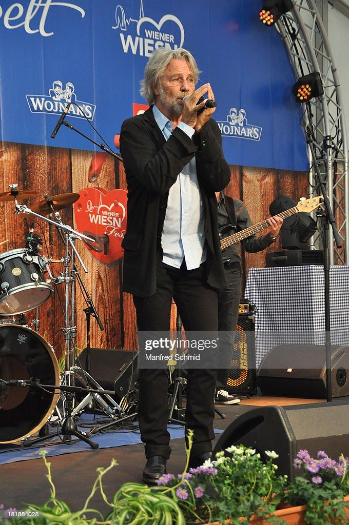 Adi Hirschal performs on stage during the 'Wiener Wirten Tag' as part of Wiener Wiesn Festival 2013 on September 25, 2013 in Vienna, Austria.