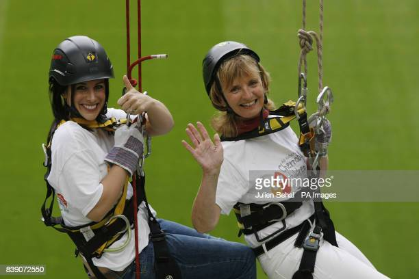 Adi Roche CEO of Chernobyl Children International and TV presenter Lucy Kennedy high up on an abseil in the Aviva Stadium Dublin to launch one of the...