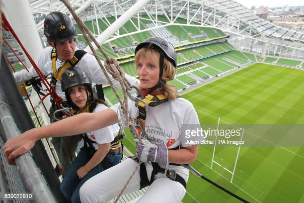 Adi Roche CEO of Chernobyl Children International gets some last minute instructions with Lucy Kennedy and Conall Mallen high up on an abseil in the...