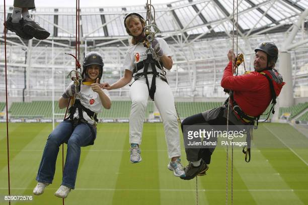 Adi Roche CEO of Chernobyl Children International with TV presenter Lucy Kennedy and Mike O' Shea of Work at Height training high up on an abseil in...