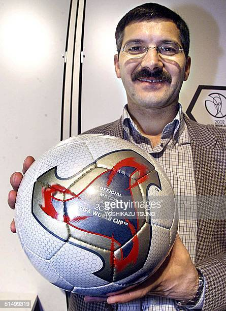Adidas CEO Herbert Hainer unveils the official match ball for the World Cup 2002 in Pusan 30 November 2001 one day ahead of the World Cup draw...