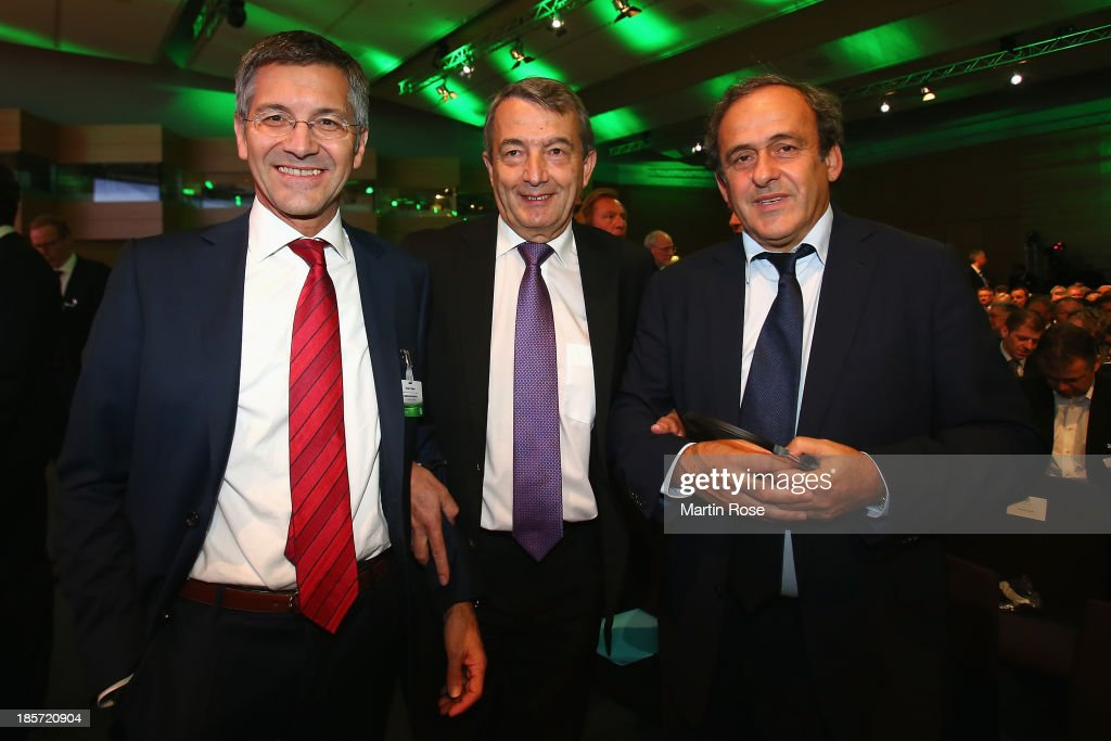 Adidas chairman Herbert Hainer, DFB president Wolfgang Niersbach and UEFA president Michel Platini pose prior to the DFB Bundestag at the NCC Nuremberg on October 24, 2013 in Nuremberg, Germany.