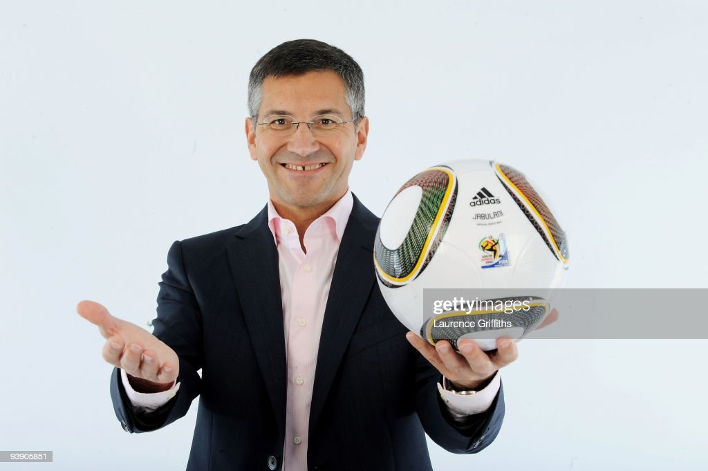 Adidas Chief Executive <a gi-track='captionPersonalityLinkClicked' href=/galleries/search?phrase=Herbert+Hainer&family=editorial&specificpeople=543915 ng-click='$event.stopPropagation()'>Herbert Hainer</a> presents the official match ball for the FIFA World Cup 2010 on December 4, 2009 in Cape Town, South Africa.