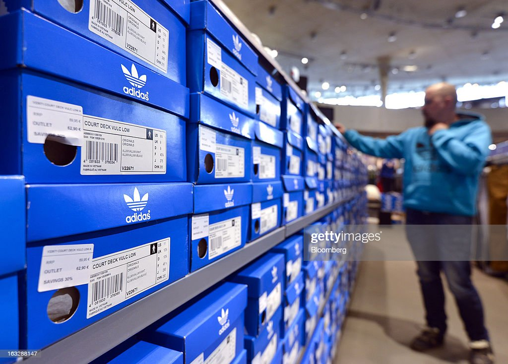 Adidas footwear is seen in branded boxes on display at the Adidas AG outlet store in Herzogenaurach, Germany, on Thursday, March 7, 2013. Adidas AG, the world's second-largest sporting-goods maker, forecast higher sales and profit this year and raised its dividend by 35 percent as it targets fast-growing emerging markets and introduces new products. Photographer: Guenter Schiffmann/Bloomberg via Getty Images