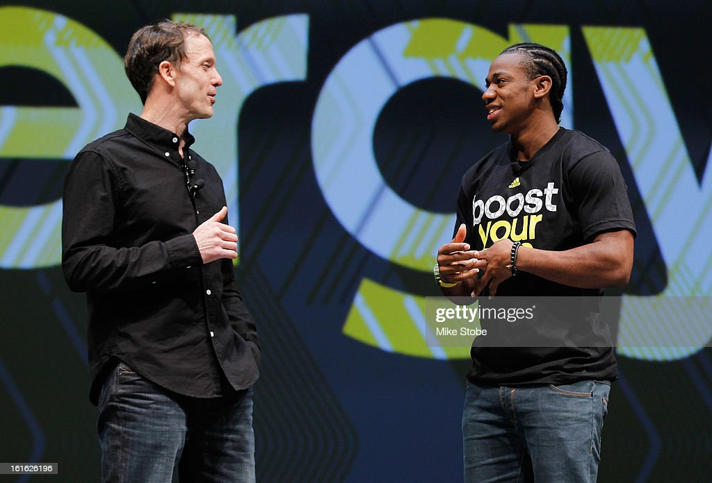 Adidas Head of Sport Performance Eric Liedtke interviews Olympic Medalist Yohan Blake during the unveiling of the adidas Energy Boost sneaker at the Javits Convention Center North on February 13, 2013 in New York City.
