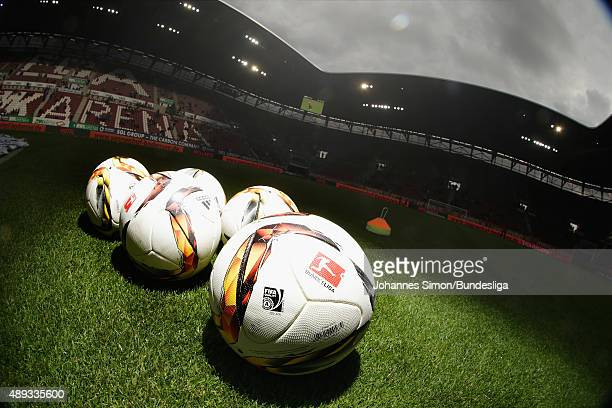 Adidas match balls lay on the pitch ahead of the Bundesliga match between FC Augsburg and Hannover 96 at WWK Arena on September 20 2015 in Augsburg...