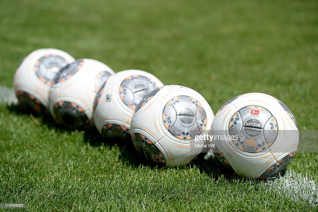 Adidas Torfabrik soccer balls lay on the sideline prior to the Third League match between Jahn Regensburg and SpVgg Unterhaching at Jahnstadion on July 20, 2013 in Regensburg, Germany.