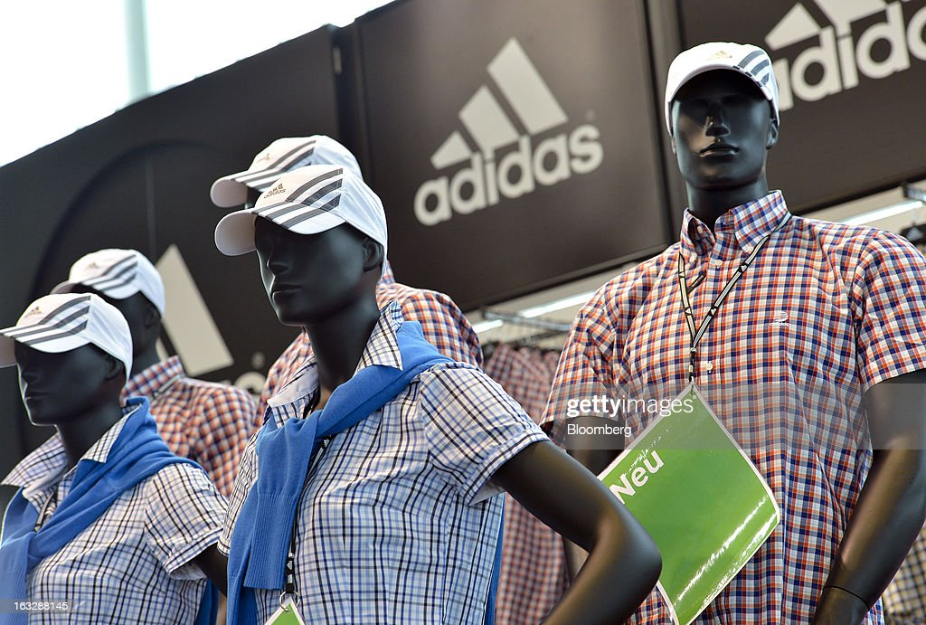 Adidas-branded clothing is displayed on mannequins at the Adidas AG outlet store in Herzogenaurach, Germany, on Thursday, March 7, 2013. Adidas AG, the world's second-largest sporting-goods maker, forecast higher sales and profit this year and raised its dividend by 35 percent as it targets fast-growing emerging markets and introduces new products. Photographer: Guenter Schiffmann/Bloomberg via Getty Images