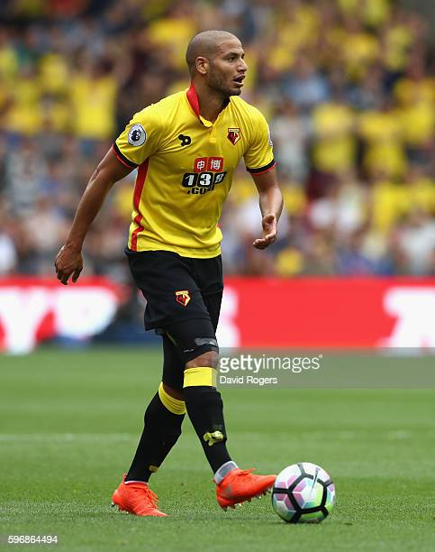 Adiene Guedioura of Watford runs with the ball during the Premier League match between Watford and Arsenal at Vicarage Road on August 27 2016 in...