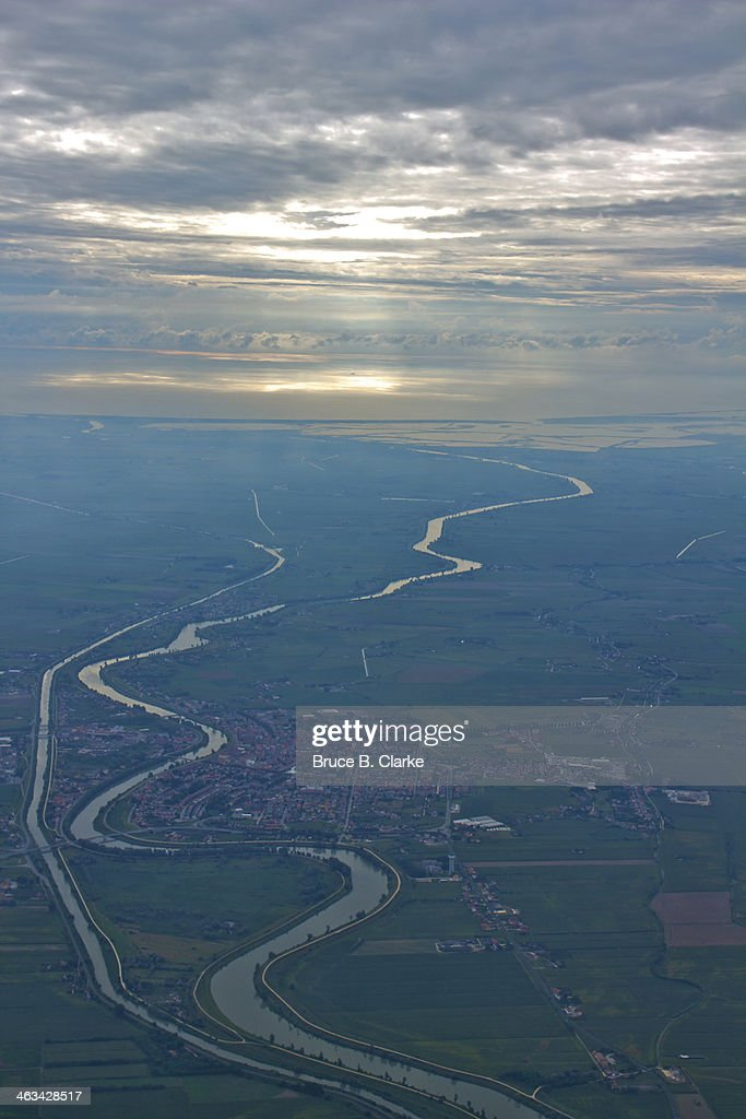 Adige River flowing into the Adriatic Sea : Stock Photo