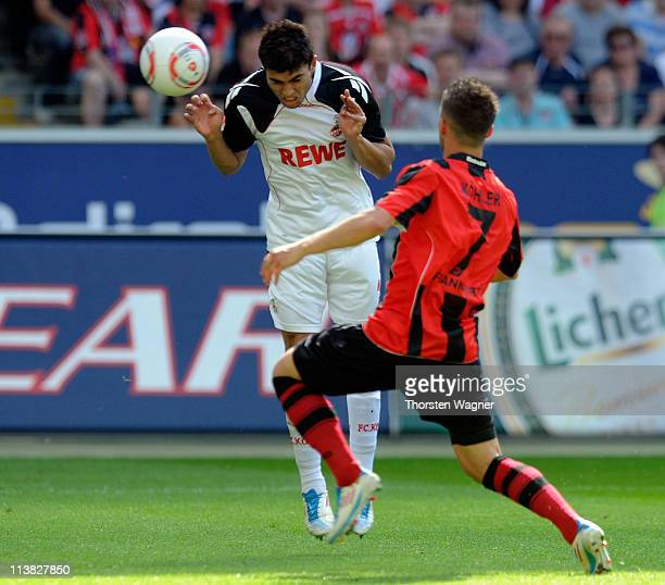 Adil Chihi of Koeln scores his teams first goal during the Bundesliga match between Eintracht Frankfurt and 1FC Koeln at Commerzbank Arena on May 7...