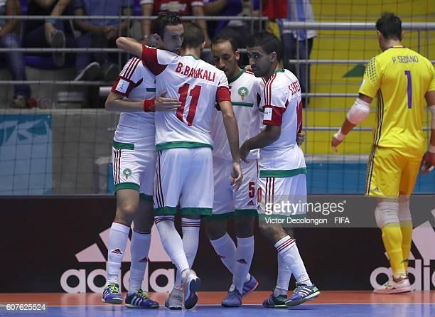 Adil Habil of Morocco celebrates after his goal with teammates Bilal Bakkali Youssef El Mazray and Soufiane El Mesrar as goalkeeper Paco Sedano of...