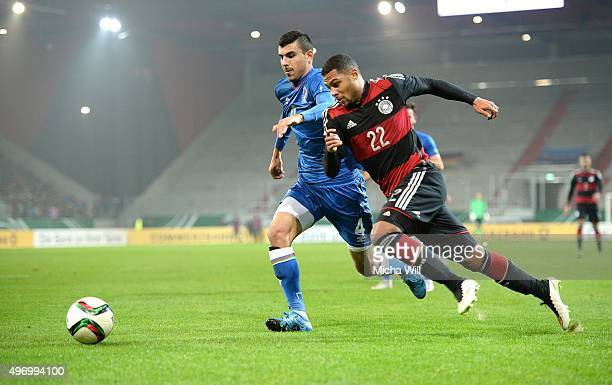 Adil Nagiev of Azerbaijan challenges Serge Gnabry of Germany during the 2017 UEFA European U21 Championships Qualifier between U21 Germany and U21...