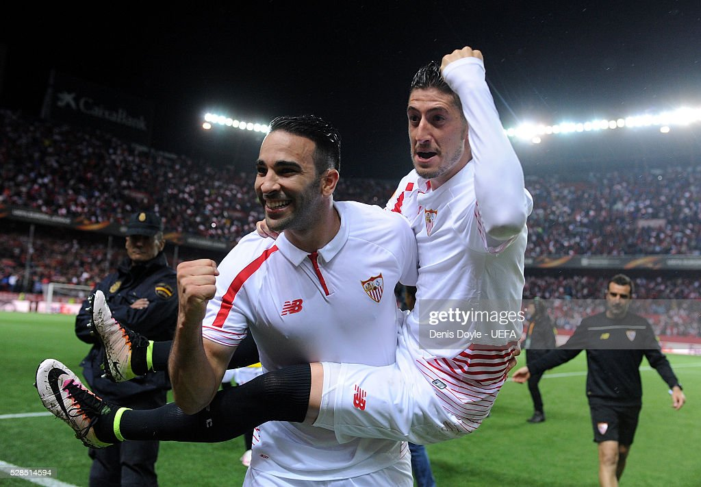 Adil Rami (L) and Sergio Escudero of Sevilla celebrate after qualifing for the final after beating Shakhtar Donetsk 3-1 in the UEFA Europa League Semi Final second leg match between Sevilla and Shakhtar Donetsk at the Sanchez Pizjuan stadium on May 5, 2016 in Seville, Spain.
