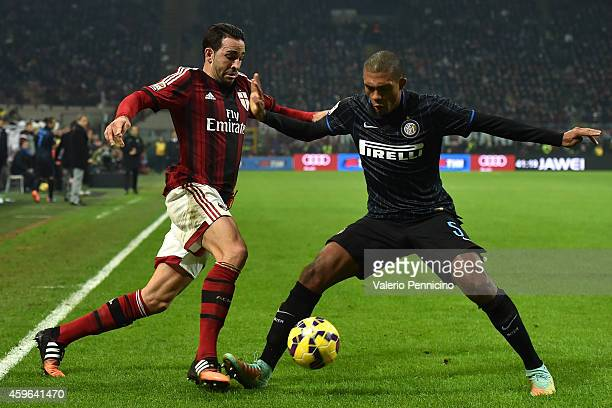 Adil Rami of AC Milan is challenged by Juan Jesus of FC Internazionale Milano during the Serie A match between AC Milan and FC Internazionale Milano...