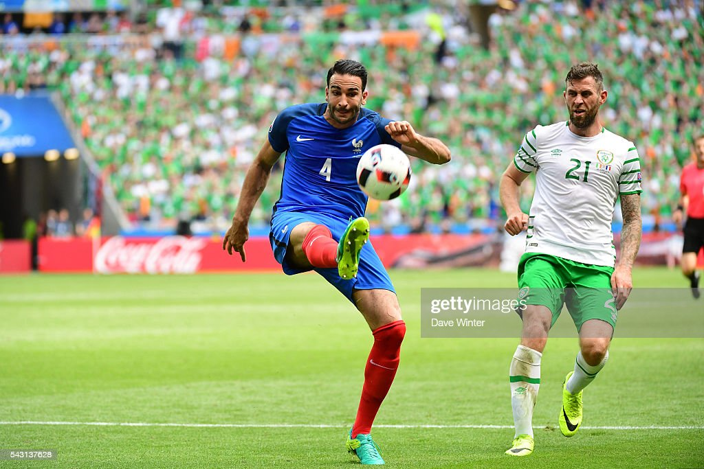 Adil Rami of France and Daryl Murphy of Republic of Ireland during the European Championship match Round of 16 between France and Republic of Ireland at Stade des Lumieres on June 26, 2016 in Lyon, France.