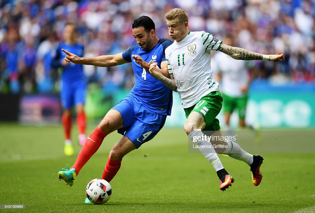 <a gi-track='captionPersonalityLinkClicked' href=/galleries/search?phrase=Adil+Rami&family=editorial&specificpeople=4305019 ng-click='$event.stopPropagation()'>Adil Rami</a> of France and <a gi-track='captionPersonalityLinkClicked' href=/galleries/search?phrase=James+McClean&family=editorial&specificpeople=3699424 ng-click='$event.stopPropagation()'>James McClean</a> of Republic of Ireland compete for the ball during the UEFA EURO 2016 round of 16 match between France and Republic of Ireland at Stade des Lumieres on June 26, 2016 in Lyon, France.
