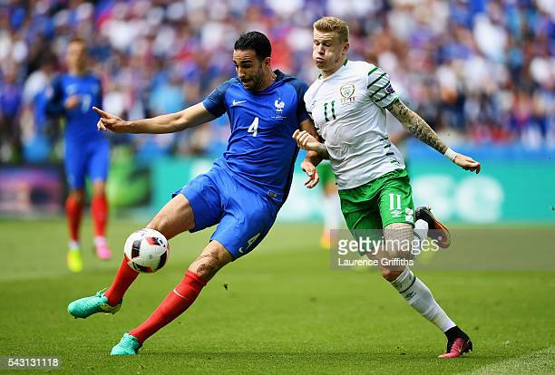 Adil Rami of France and James McClean of Republic of Ireland compete for the ball during the UEFA EURO 2016 round of 16 match between France and...