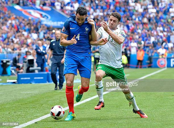 Adil Rami of France and Jeff Hendrick of The Republic of Ireland fight for the ball during the UEFA Euro 2016 round of 16 match between France and...