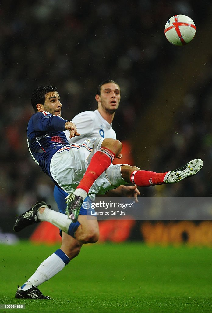 Adil Rami of France clears the ball ahead of Andy Carroll of England during the international friendly match between England and France at Wembley Stadium on November 17, 2010 in London, England.