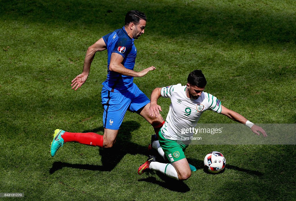 <a gi-track='captionPersonalityLinkClicked' href=/galleries/search?phrase=Adil+Rami&family=editorial&specificpeople=4305019 ng-click='$event.stopPropagation()'>Adil Rami</a> of France fouls <a gi-track='captionPersonalityLinkClicked' href=/galleries/search?phrase=Shane+Long&family=editorial&specificpeople=661194 ng-click='$event.stopPropagation()'>Shane Long</a> of Republic of Ireland resulting in an yellow card during the UEFA EURO 2016 round of 16 match between France and Republic of Ireland at Stade des Lumieres on June 26, 2016 in Lyon, France.