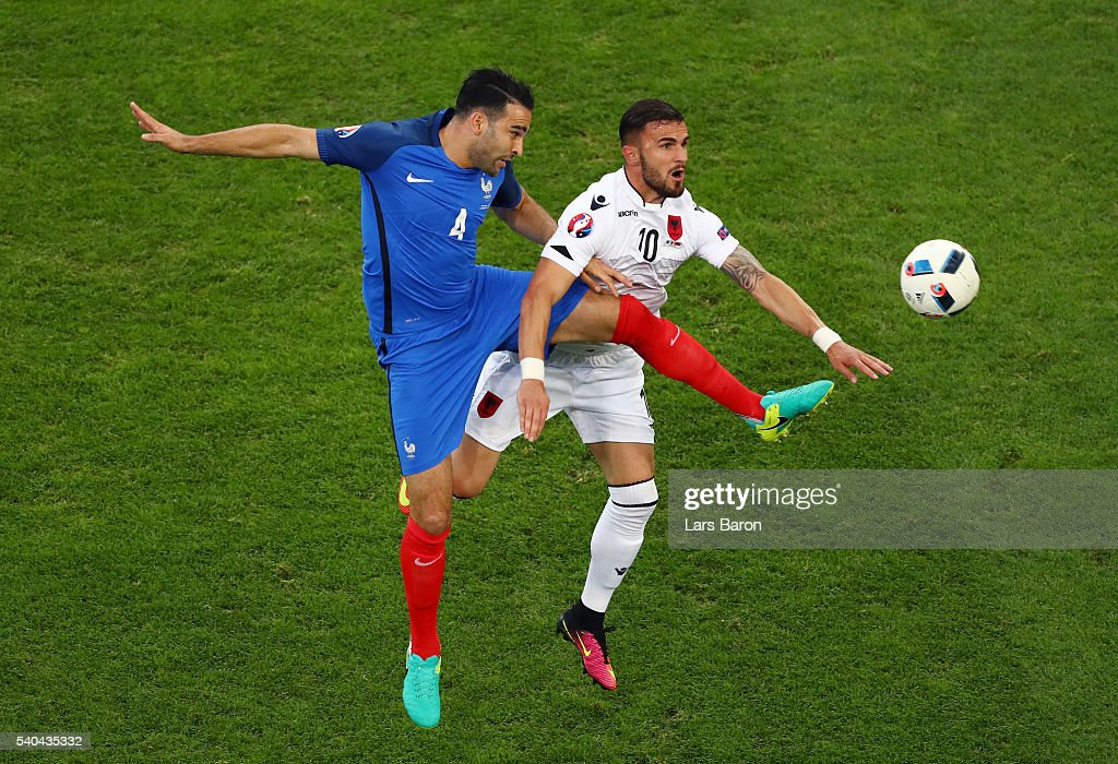 <a gi-track='captionPersonalityLinkClicked' href=/galleries/search?phrase=Adil+Rami&family=editorial&specificpeople=4305019 ng-click='$event.stopPropagation()'>Adil Rami</a> of France makes a challenge on <a gi-track='captionPersonalityLinkClicked' href=/galleries/search?phrase=Armando+Sadiku&family=editorial&specificpeople=9428222 ng-click='$event.stopPropagation()'>Armando Sadiku</a> of Albania during the UEFA EURO 2016 Group A match between France and Albania at Stade Velodrome on June 15, 2016 in Marseille, France.