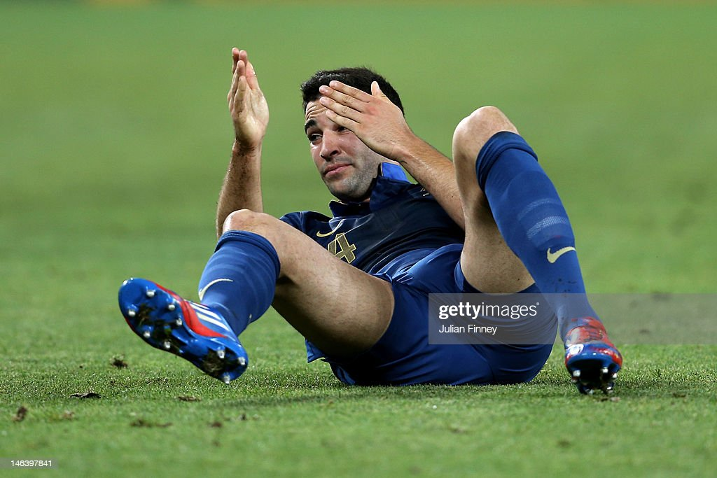 <a gi-track='captionPersonalityLinkClicked' href=/galleries/search?phrase=Adil+Rami&family=editorial&specificpeople=4305019 ng-click='$event.stopPropagation()'>Adil Rami</a> of France reacts during the UEFA EURO 2012 group D match between Ukraine and France at Donbass Arena on June 15, 2012 in Donetsk, Ukraine.