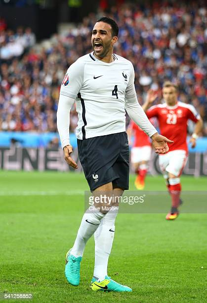 Adil Rami of France reacts during the UEFA EURO 2016 Group A match between Switzerland and France at Stade PierreMauroy on June 19 2016 in Lille...