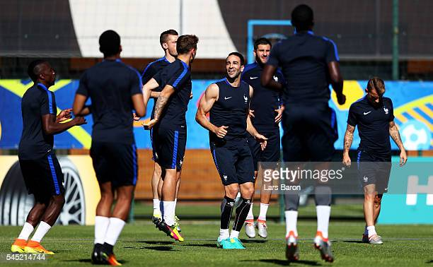 Adil Rami of France warms up during a France training session ahead of their UEFA Euro 2016 Semi final against Germany on July 6 2016 in Marseille...