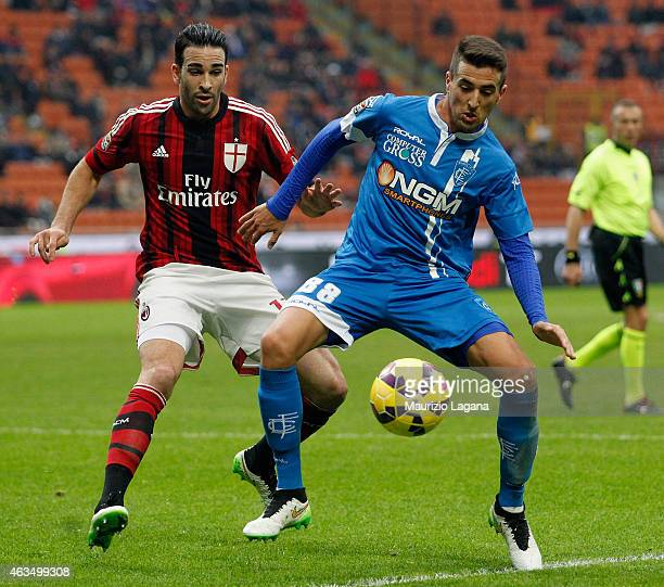 Adil Rami of Milan competes for the ball with Matias Vecino of Empoli during the Serie A match between AC Milan and Empoli FC at Stadio Giuseppe...