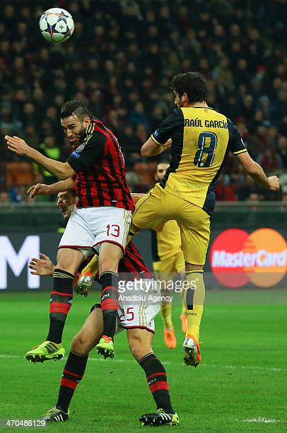 Adil Rami of Milan vies for the ball with Raul Garcia of Atletico Madrid during the UEFA Champions League round of 16 soccer match between AC Milan...
