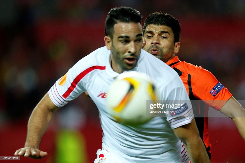 Adil Rami (front) of Sevilla and Taison (rear) of Shakhtar Donetsk vie for the ball during the UEFA Europa League semi-final second leg football match between Sevilla and Shakhtar Donetsk at the Sanchez Pizjuan Stadium in Sevilla, Spain on May 5, 2016.