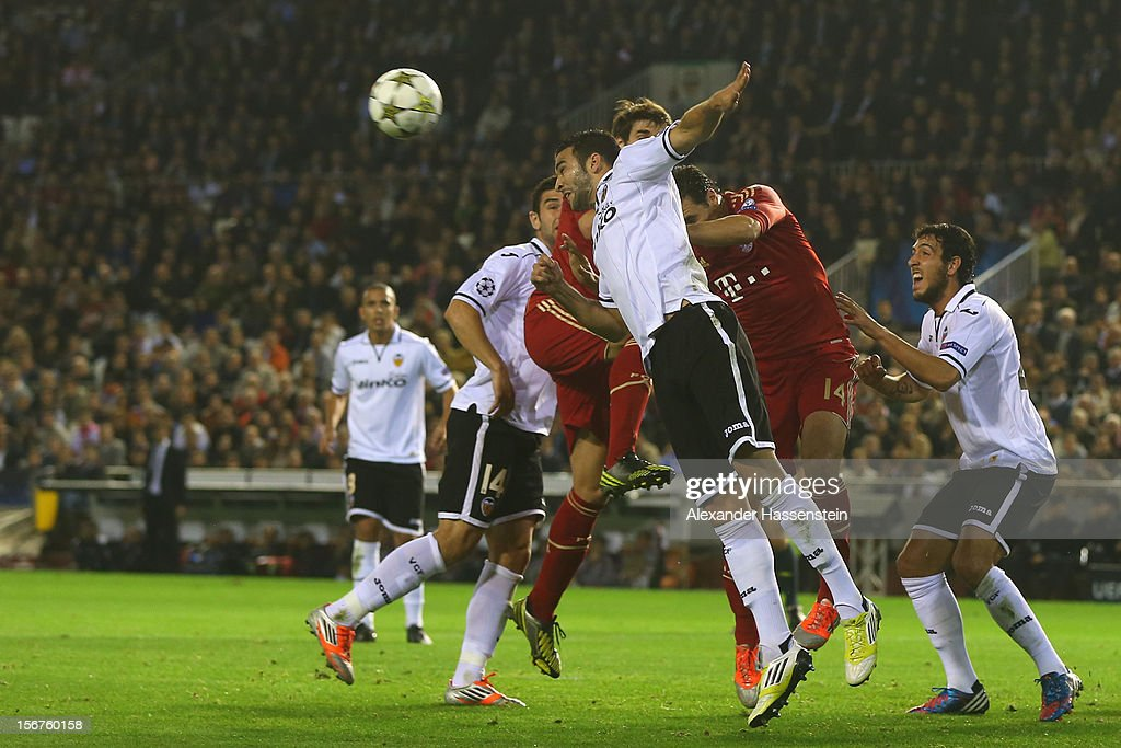 Adil Rami (C) of Valencia battles for the ball with Javi Martinez of Bayern Muenchen and his team mate Claudio Pizarro during the UEFA Champions League group F match between Valencia FC and FC Bayern Muenchen at Estadio Mestalla on November 20, 2012 in Valencia, Spain.