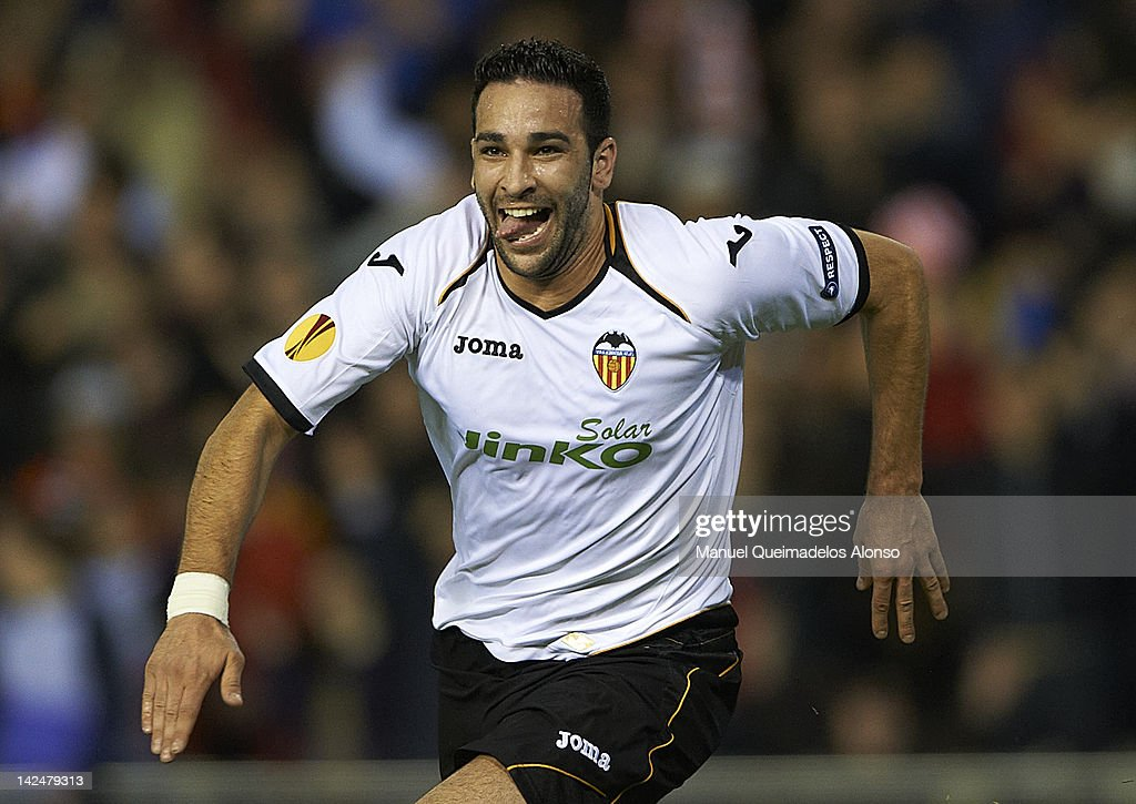 <a gi-track='captionPersonalityLinkClicked' href=/galleries/search?phrase=Adil+Rami&family=editorial&specificpeople=4305019 ng-click='$event.stopPropagation()'>Adil Rami</a> of Valencia CF celebrates after scoring the second goal during the UEFA Europa League quarter final second leg match between Valencia CF and AZ Alkmaar at Estadio Mestalla on April 5, 2012 in Valencia, Spain.