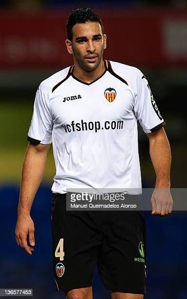 Adil Rami of Valencia looks on during the La Liga match between Villarreal and Valencia at Estadio El Madrigal on January 8 2012 in Villarreal Spain