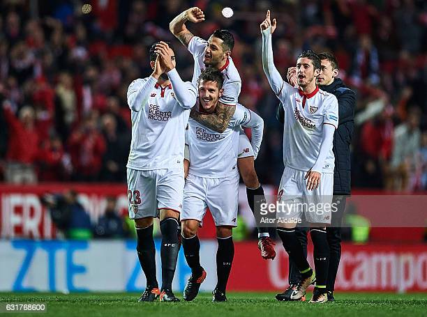 Adil Rami Victor Machin Perez 'Vitolo' Stevan Jovetic and Sergio Escudero of Sevilla FC celebrates after winning the match against Real Madrid CF...