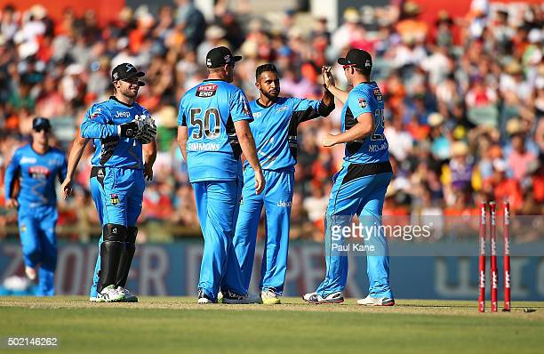 Adil Rashid and Jon Holland of the Strikers celebrate the wicket of Michael Carberry of the Scorchers during the Big Bash League match between Perth...