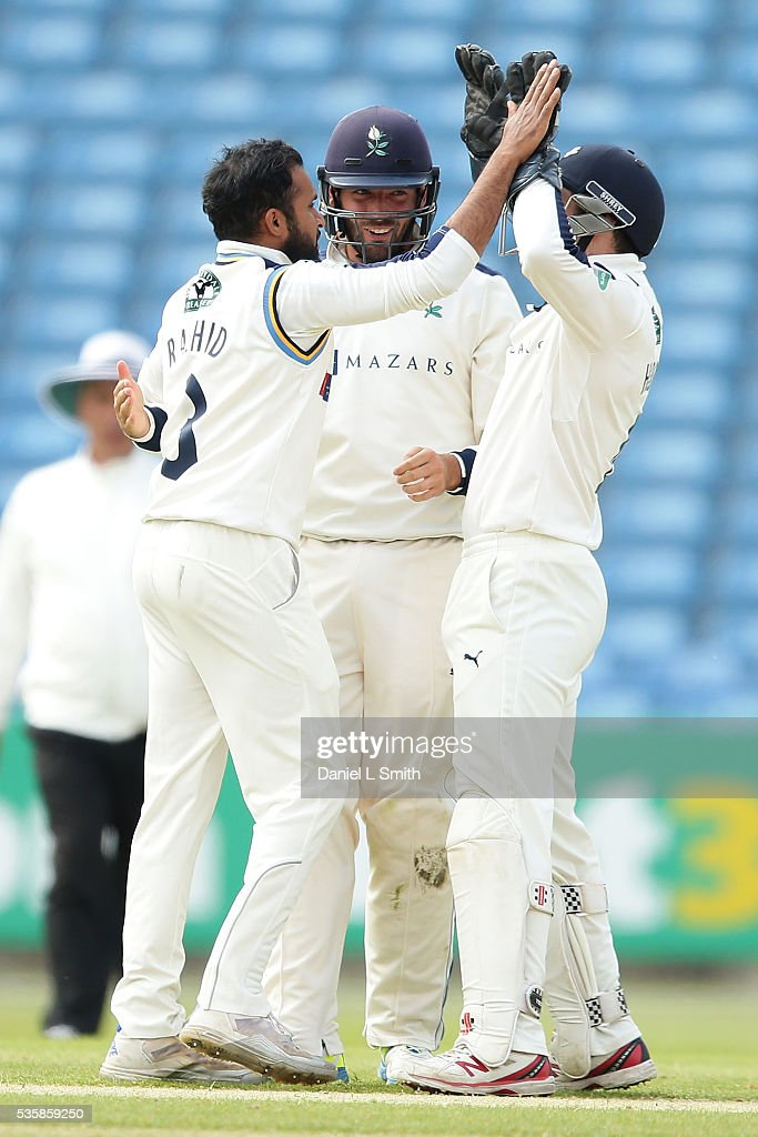 Adil Rashid (L). Jack Leaning (C) and Andy Hodd (R) of Yorkshire celebrate the LBW of Neil Wagner of Lancashire during day two of the Specsavers County Championship: Division One match between Yorkshire and Lancashire at Headingley on May 30, 2016 in Leeds, England.