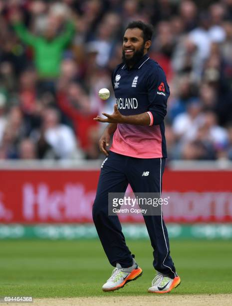 Adil Rashid of England celebrates after dismissing Pat Cummins of Australia during the ICC Champions Trophy match between England and Australia at...