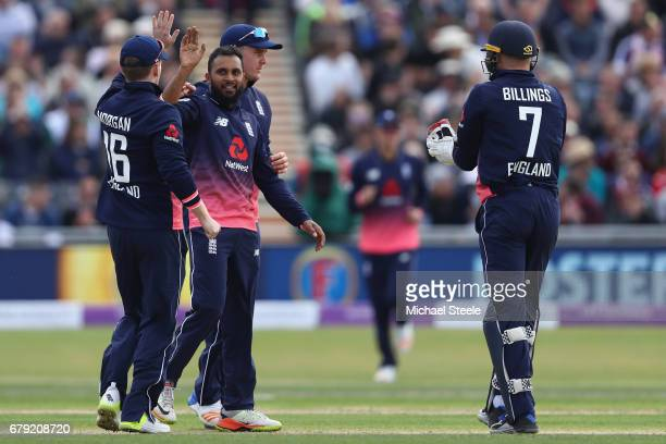 Adil Rashid of England celebrates capturing the wicket of Niall O'Brien of Ireland during the Royal London One Day International match between...