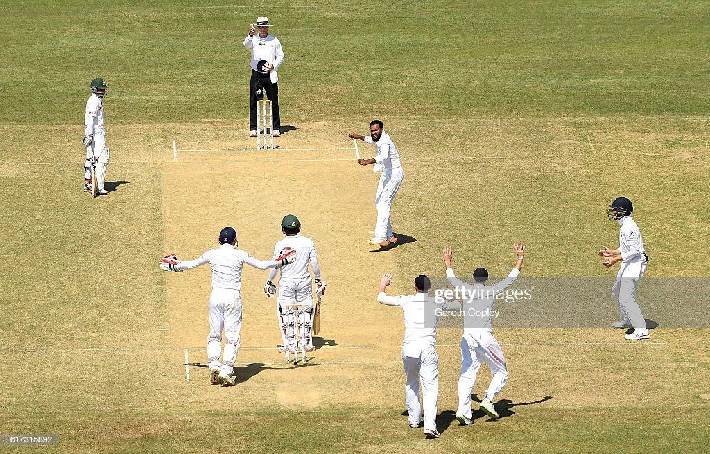 Adil Rashid of England celebrates dismissing Imrul Kayes of Bangladesh during the 4th day of the 1st Test match between Bangladesh and England at Zohur Ahmed Chowdhury Stadium on October 23, 2016 in Chittagong, Bangladesh.