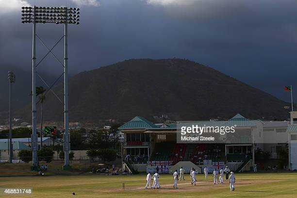Adil Rashid of England celebrates taking the wicket of Leon Clarke of St Kitts during day two of the St Kitts and Nevis Invitational XI versus...