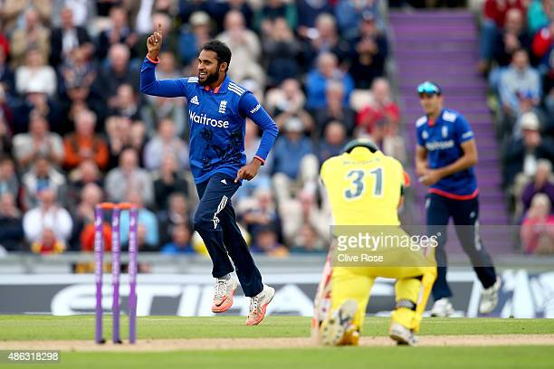 Adil Rashid of England celebrates the wicket of David Warner of Australia during the 1st Royal London OneDay International match between England and...