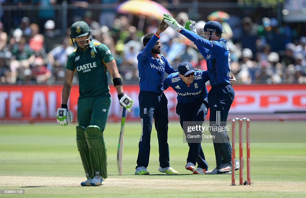 Adil Rashid of England celebrates with Jason Roy and Jos Buttler after dismissing Faf du Plessis of South Africa during the 2nd Momentum ODI between South Africa and England at St George's Park on February 6, 2016 in Port Elizabeth, South Africa.