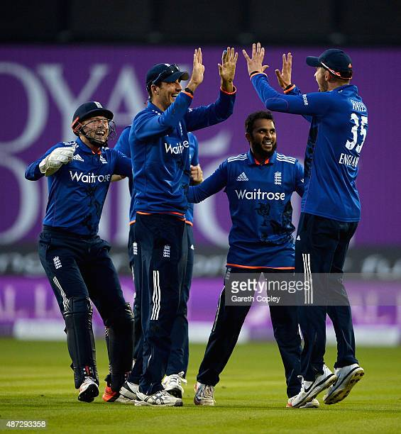 Adil Rashid of England celebrates with Jonathan Bairstow Steven Finn and Alex Hales after dismissing Australian captain Steven Smith during the 3rd...