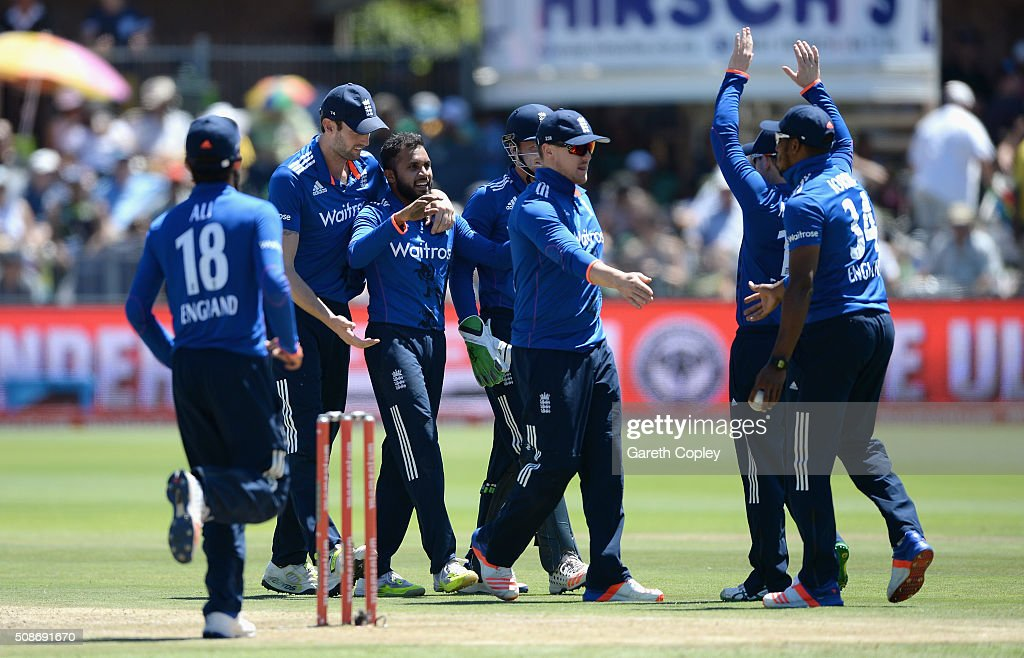 Adil Rashid of England celebrates with teammates after dismissing Faf du Plessis of South Africa during the 2nd Momentum ODI between South Africa and England at St George's Park on February 6, 2016 in Port Elizabeth, South Africa.